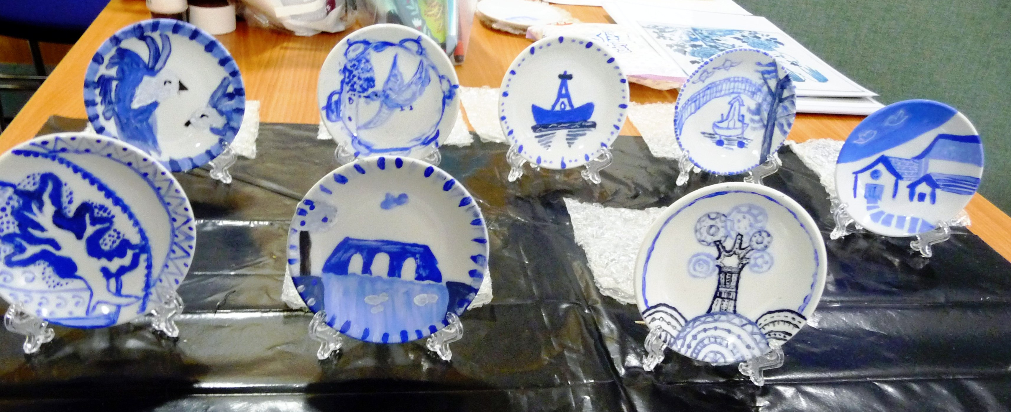 some of our YE group's completed blue and white painted plates based on the willow pattern