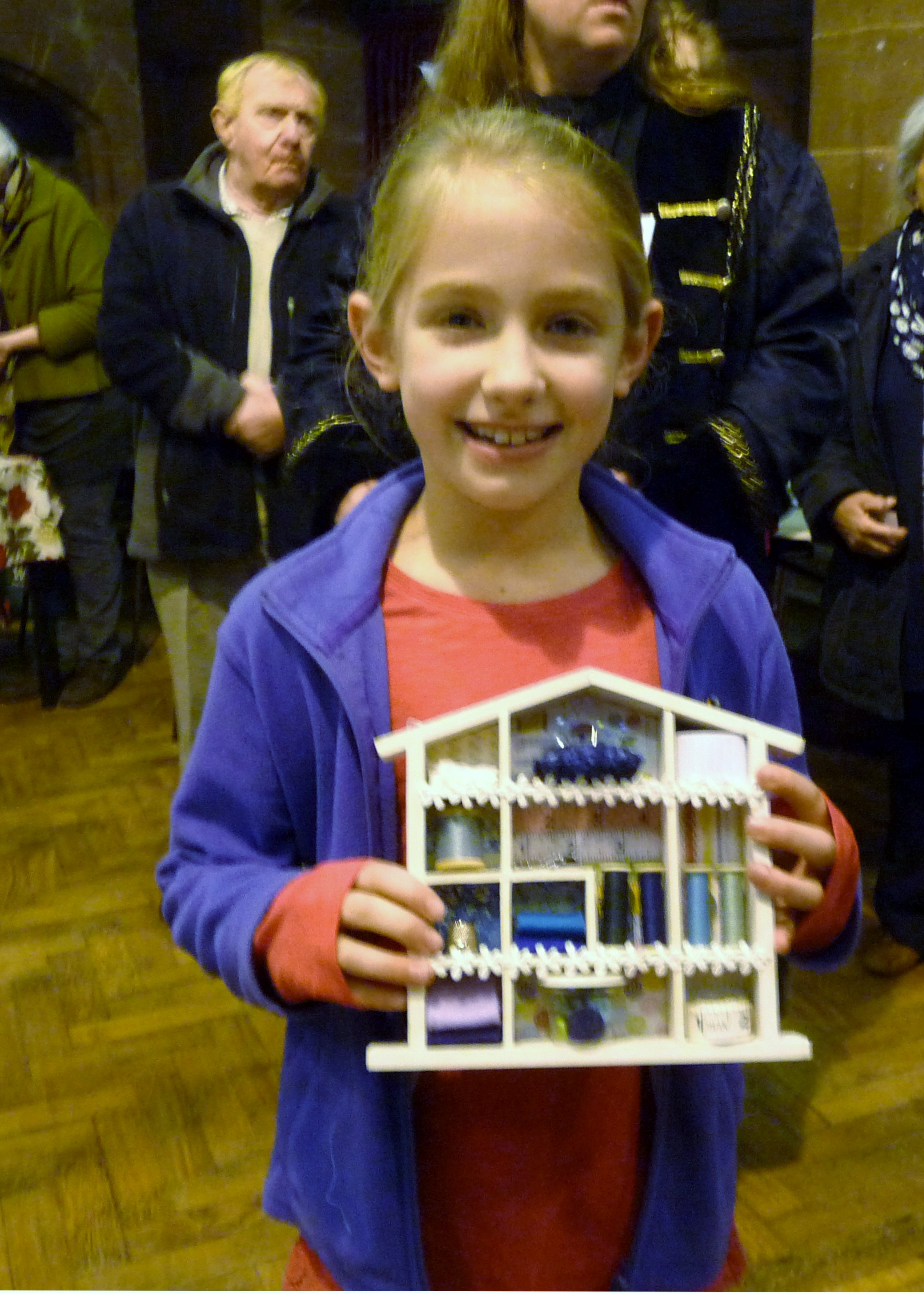 """Emma Lewis with her prizewinning """"Home From Home"""" at MEG Christmas party 2014"""