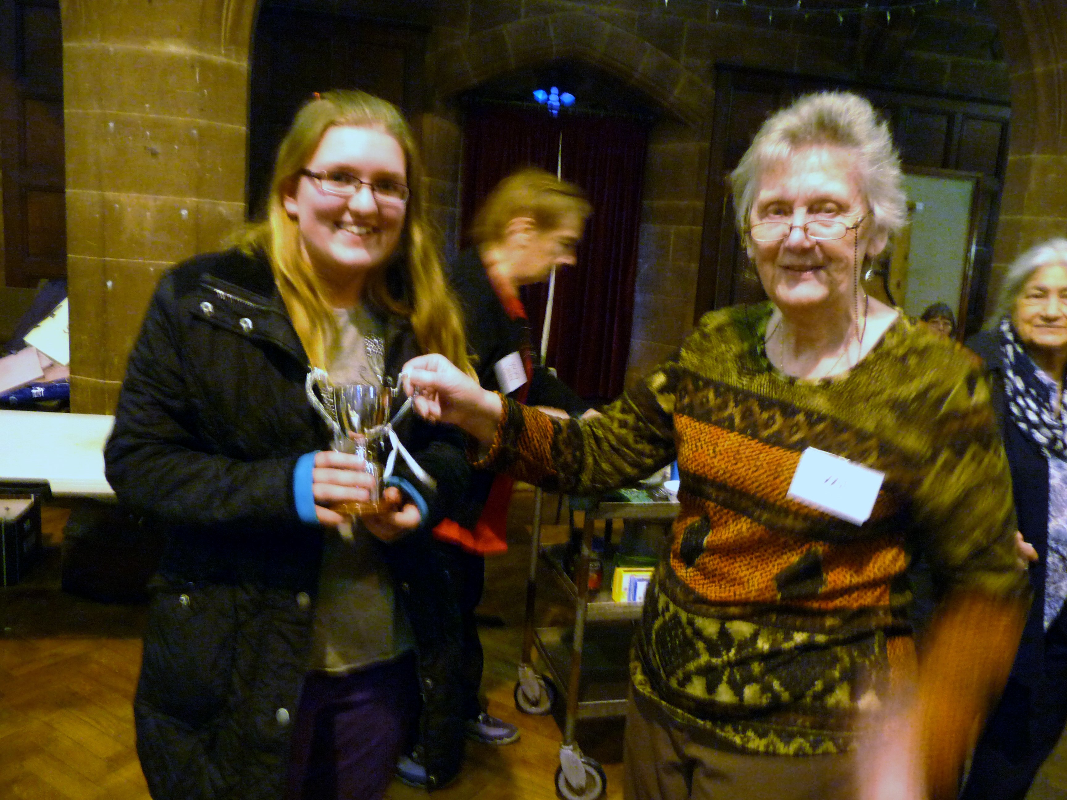 Chloe Gray, Merseyside Young Embroiderer 2014, receiving her Cup from YE Leader Val Heron at MEG Christmas party 2014