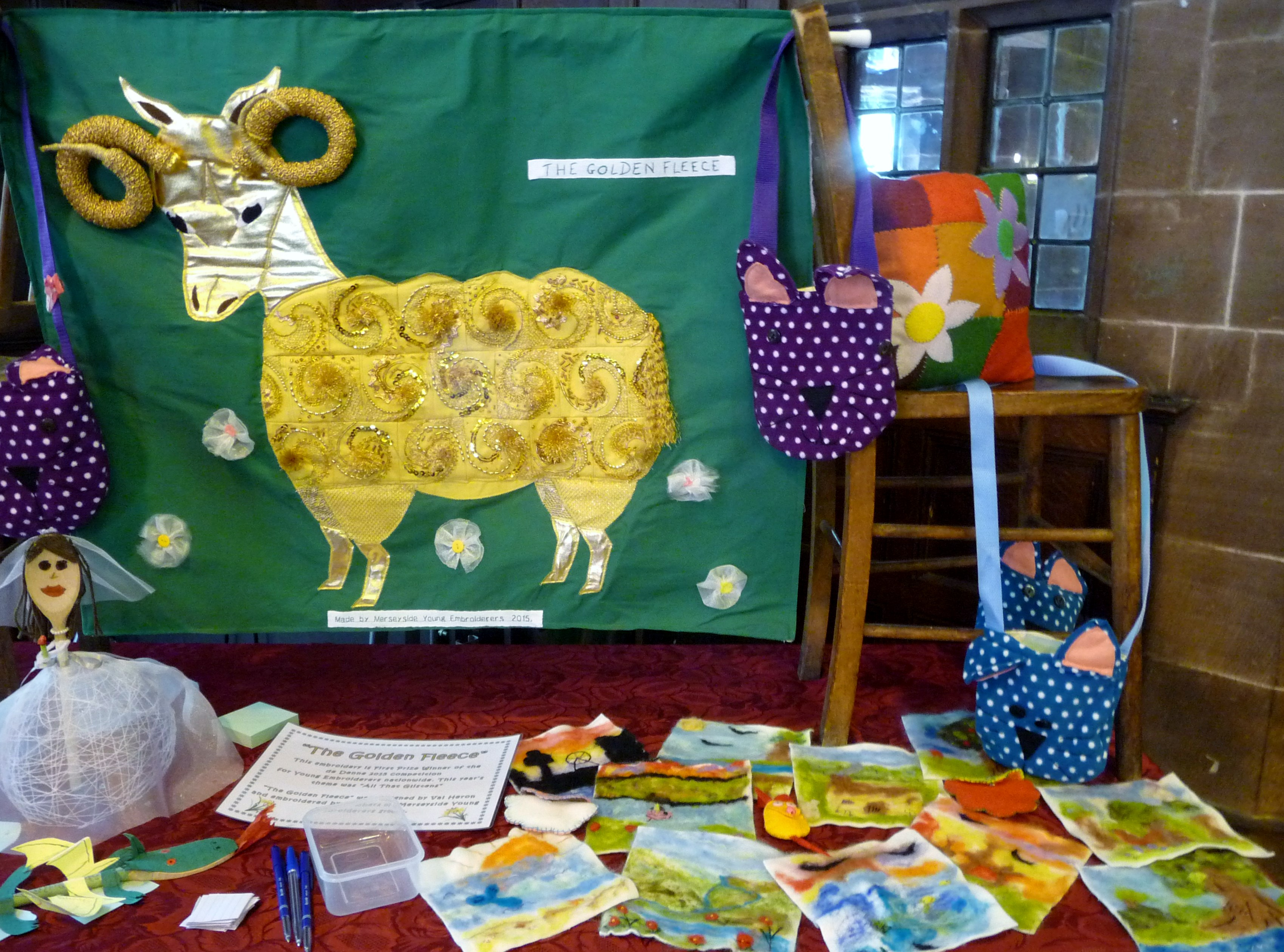 this is our YE display at MEG Summer Tea Party 2015, showing 'The Golden Fleece', 2015 winner of the Group Award of the national deDenne embroidery competion for Young Embroiderers