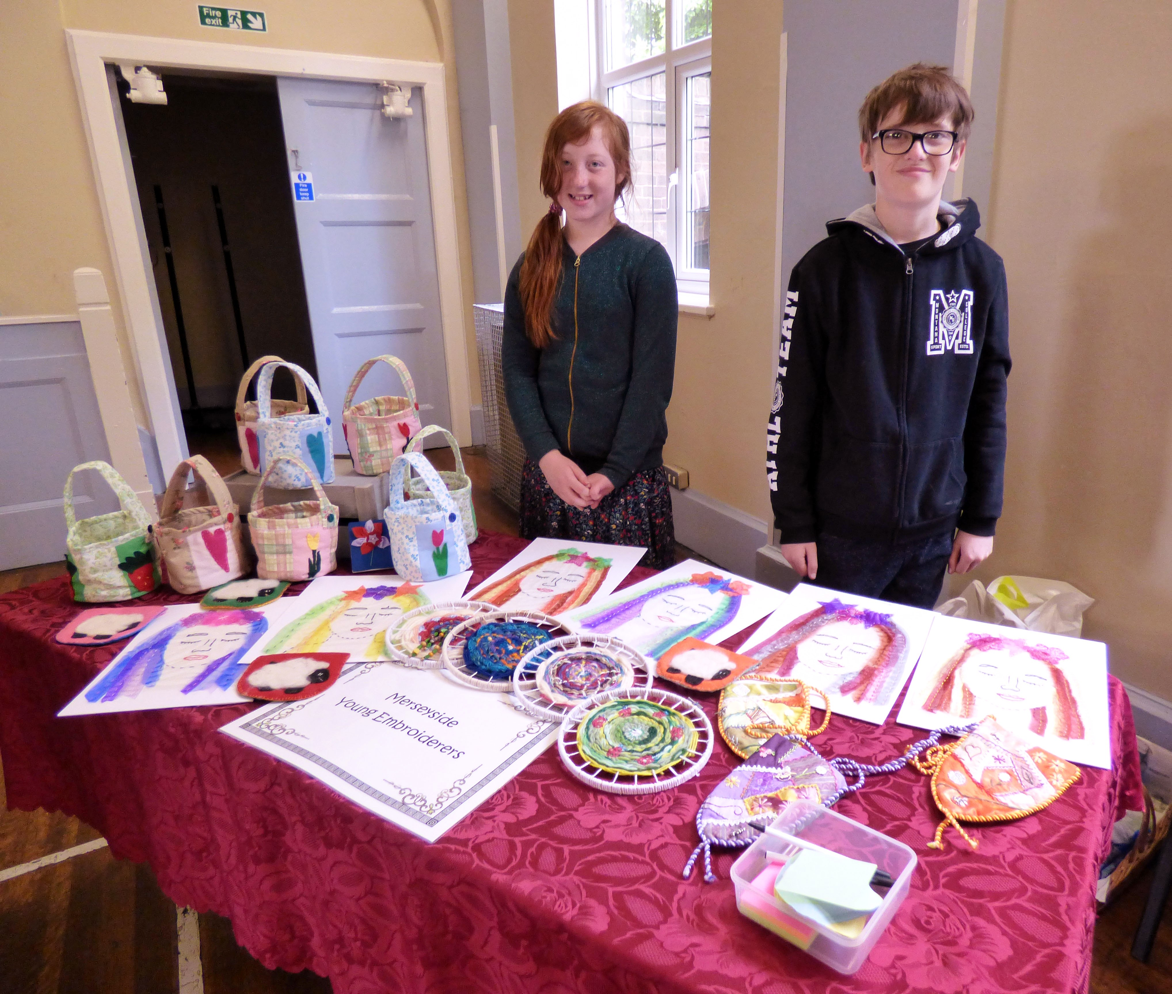 Ailis and Fionn with the YE display at MEG Summer Party 2017