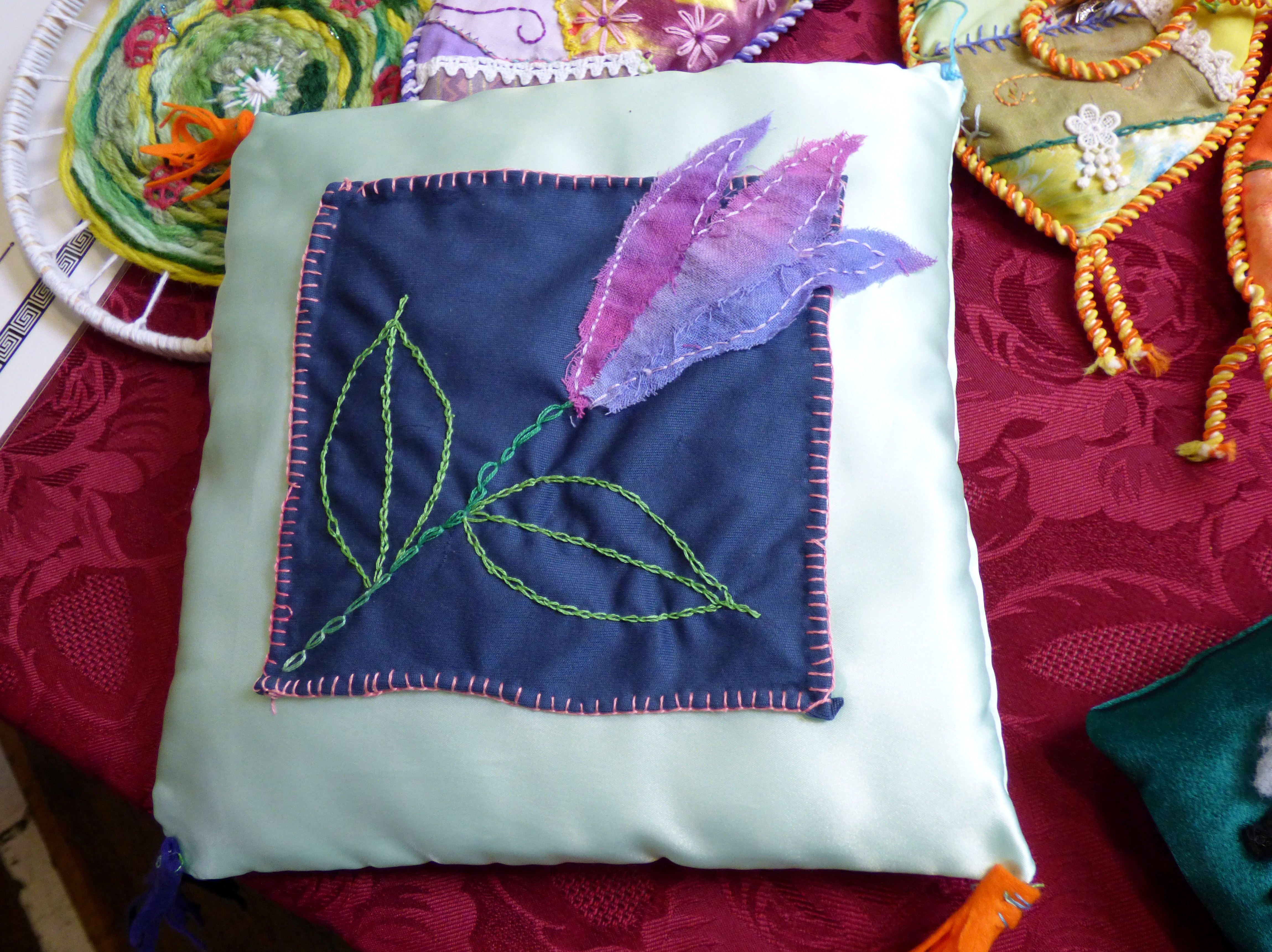 this is Grace's embroidered cushion at  MEG Summer Party 2017