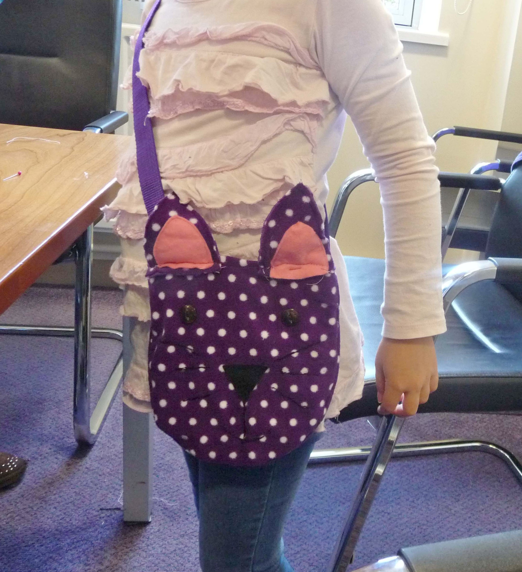 This is Esther, aged 7,  with her cat faced bag