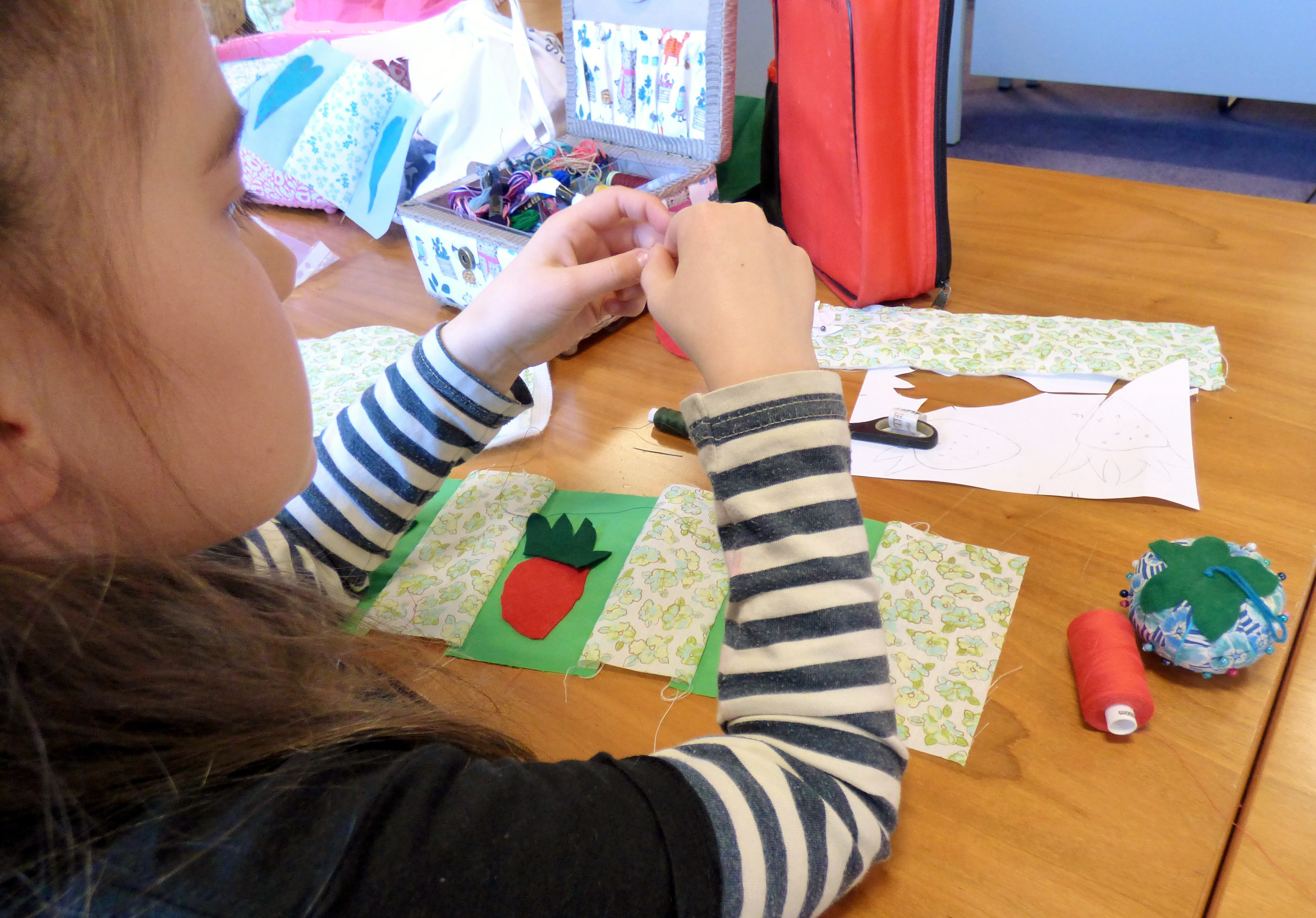 Marla has designed some strawberries to applique on the sides of her basket. YE group April 2017