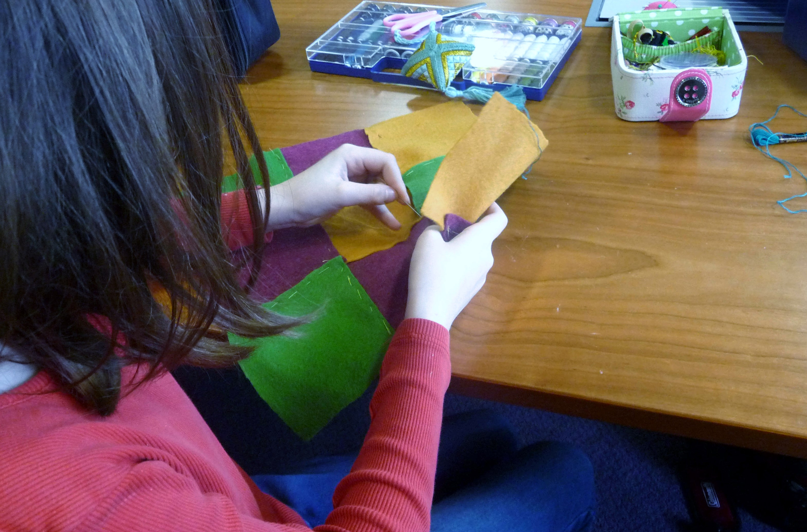 next we joined each row of squares together with tacking stitch