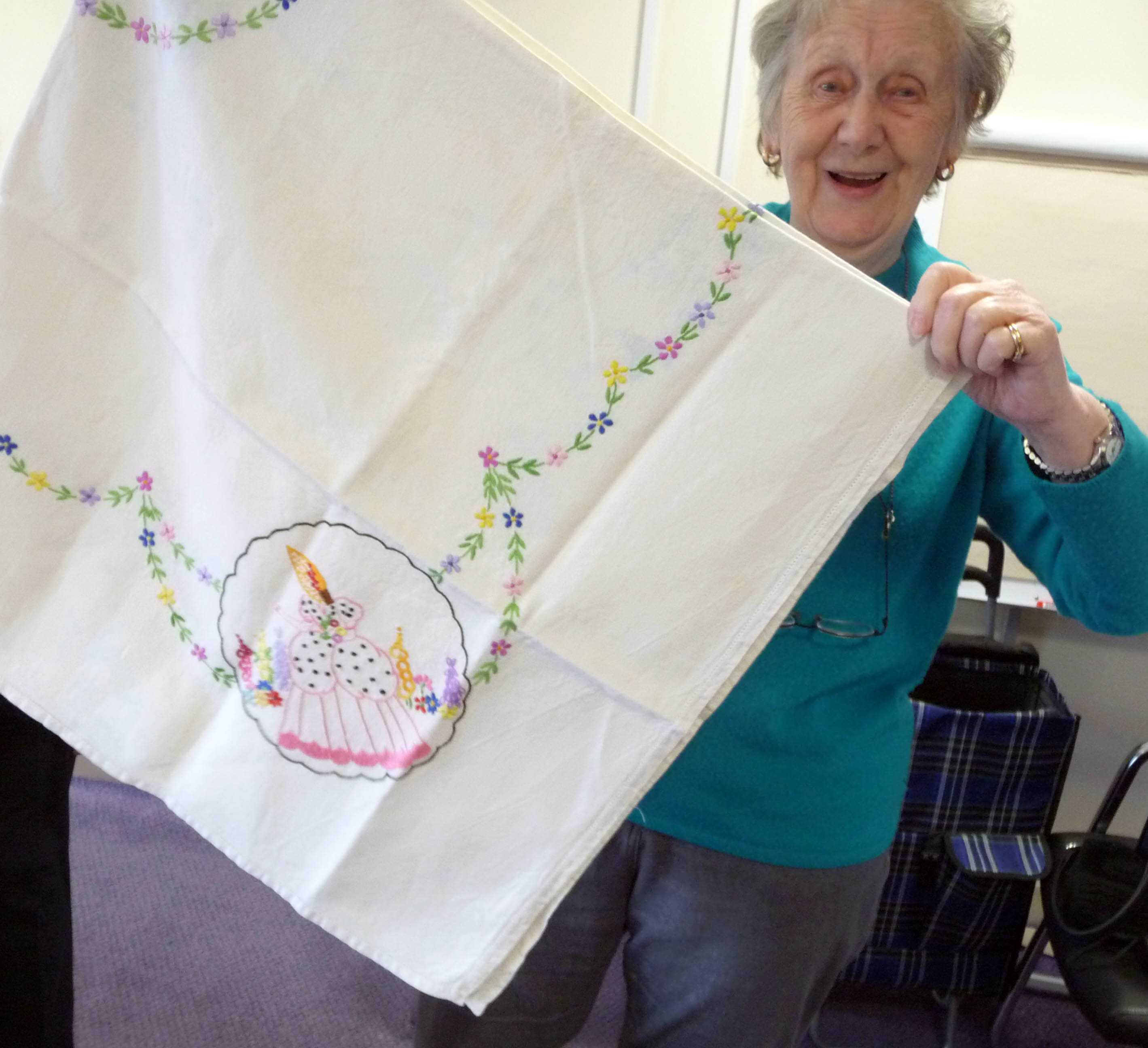 Val is showing our YE group a very old embroidered tablecloth