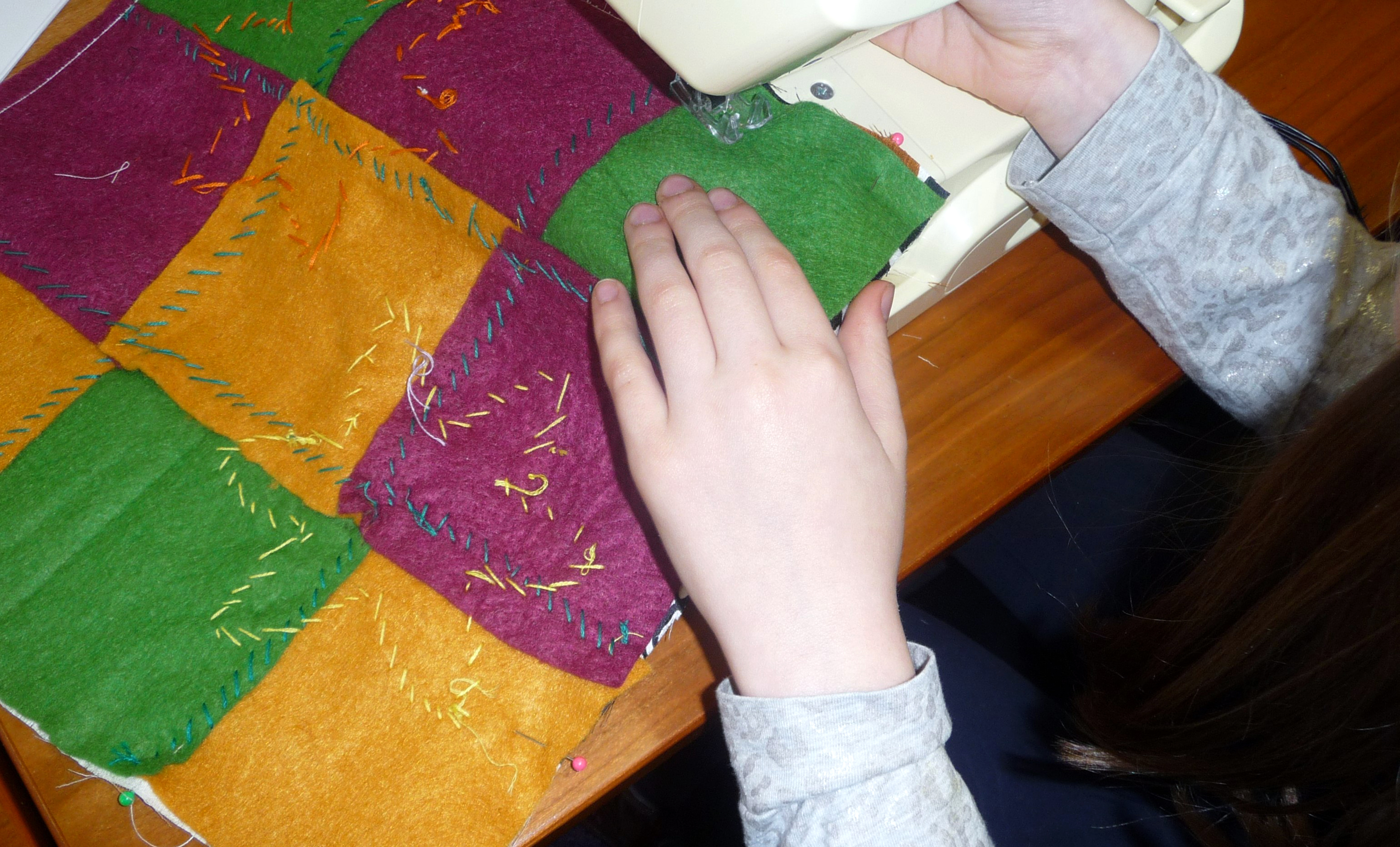 we used the sewing machine to join back and front of the cushion together during YE group meeting in March 2015