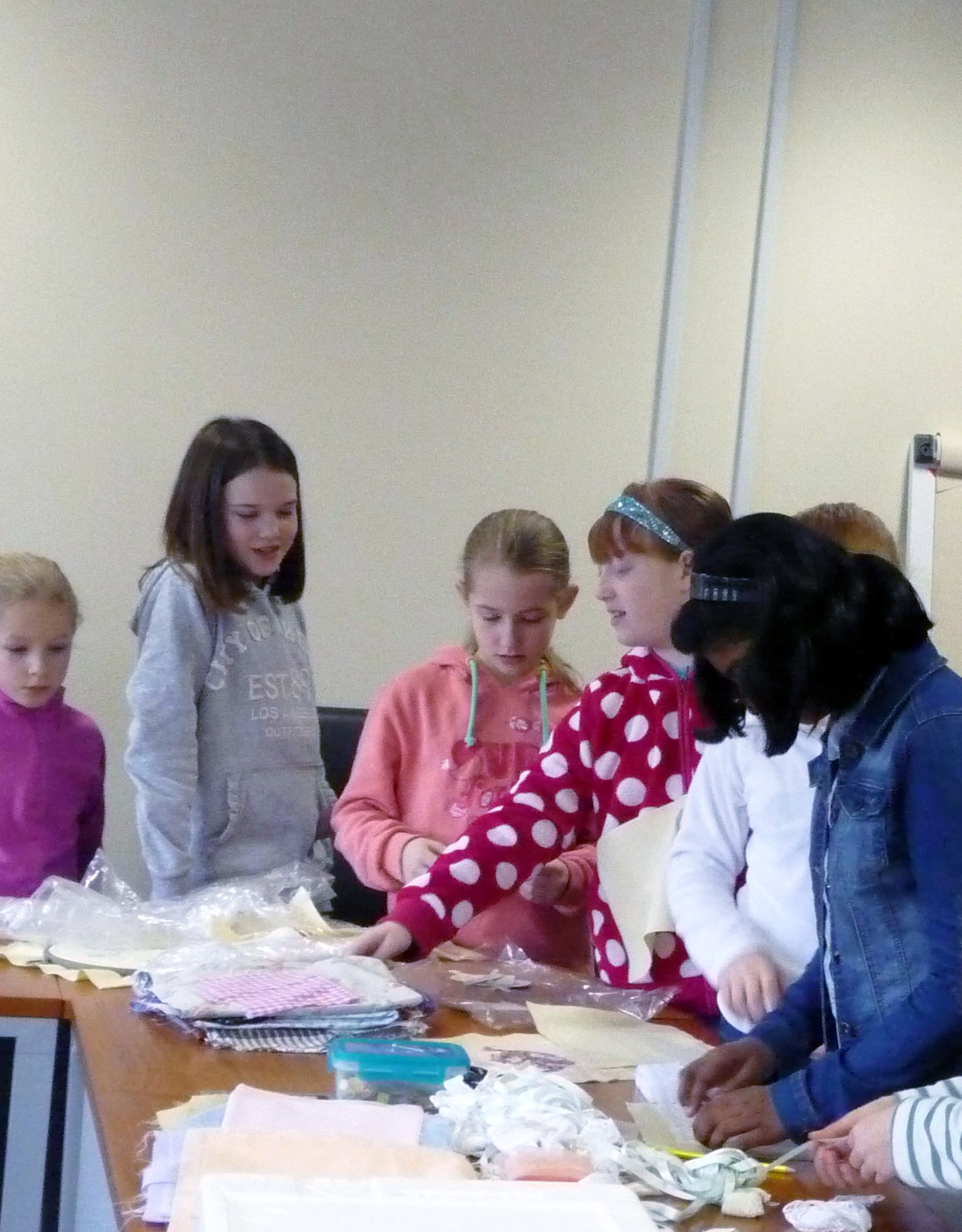 Merseyside YE choosing lace and ribbons for their latest project