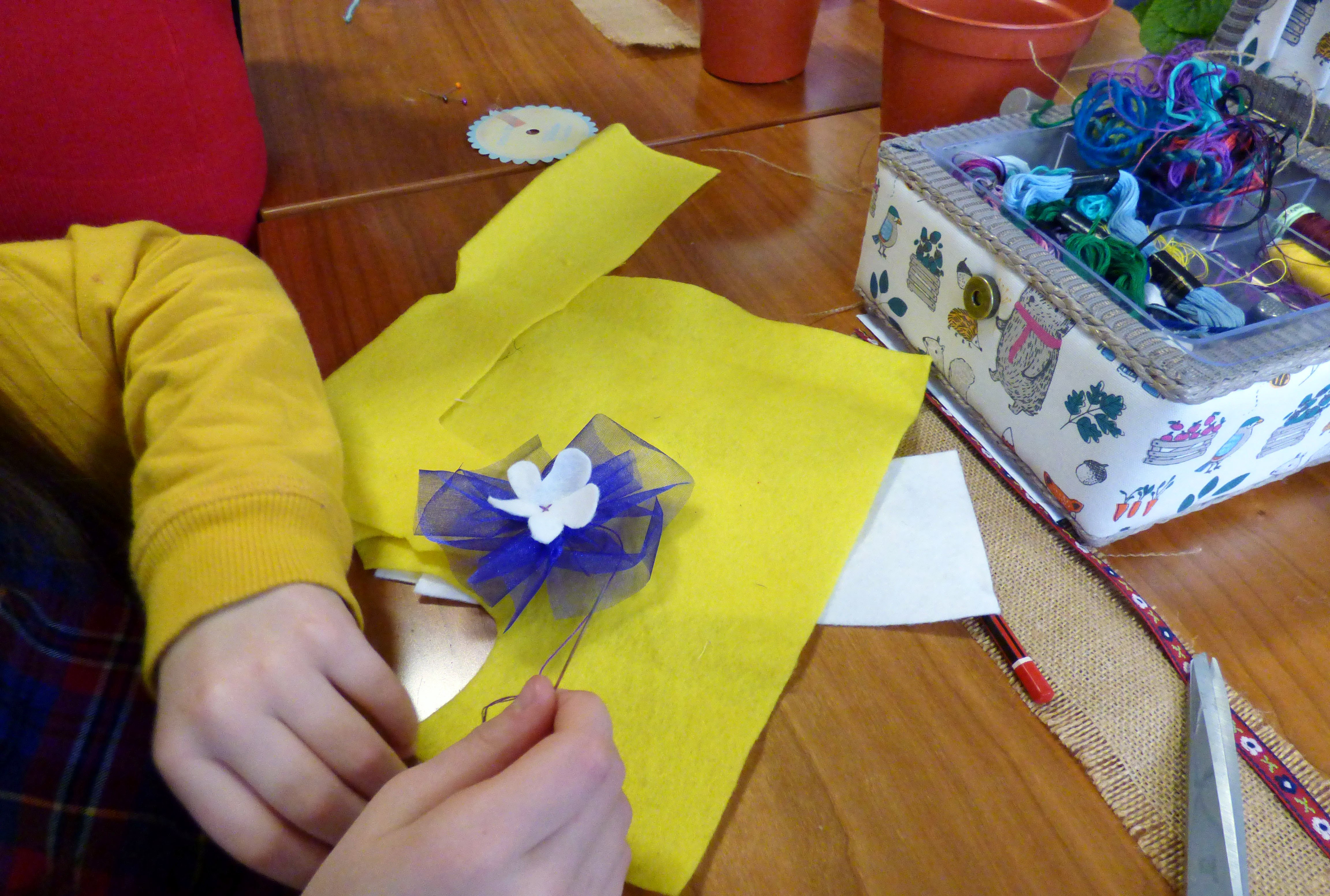 Marla is making a decorative flower to go on her plant pot band