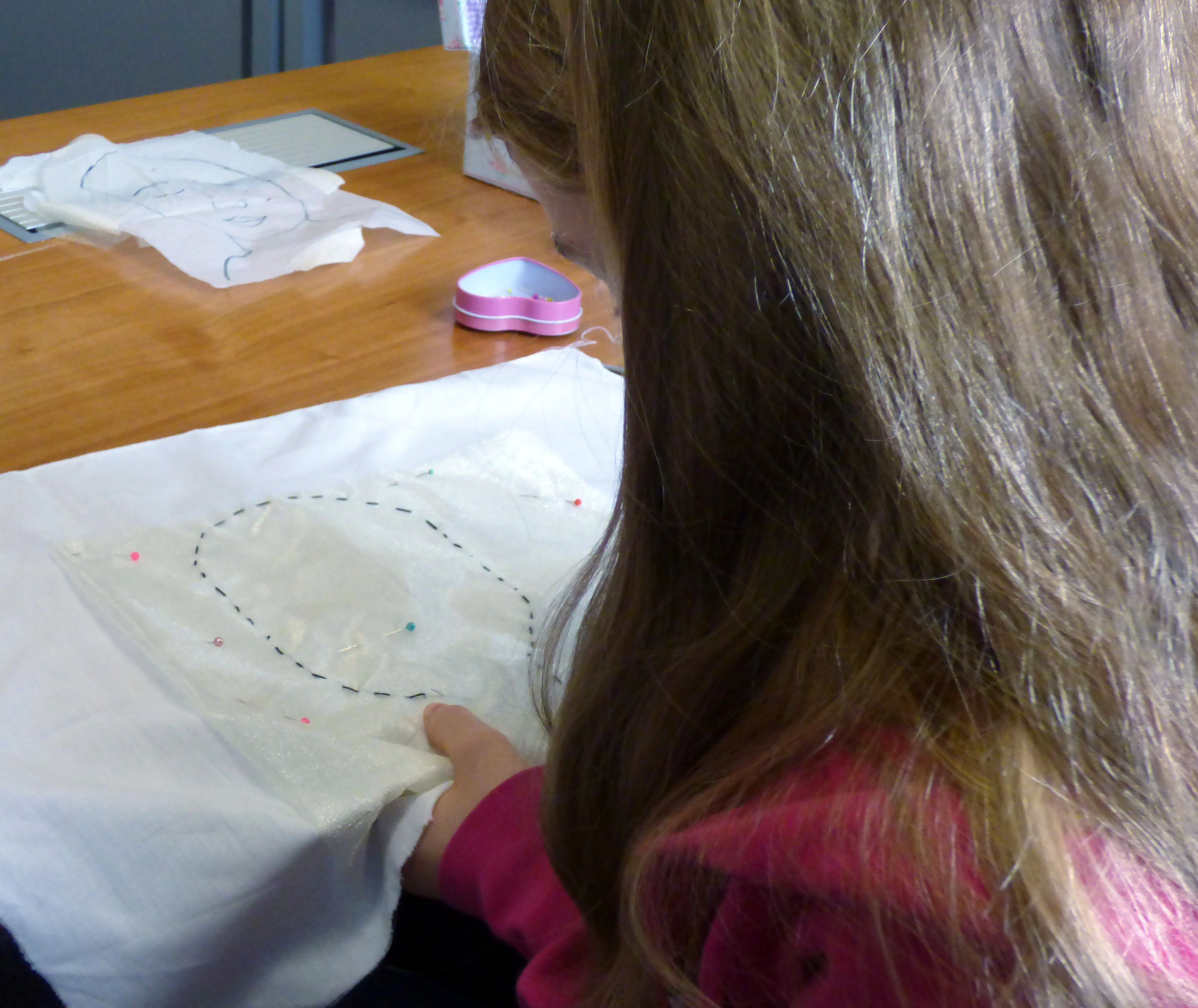 First we use running stitch to outline the face at Merseyside YE
