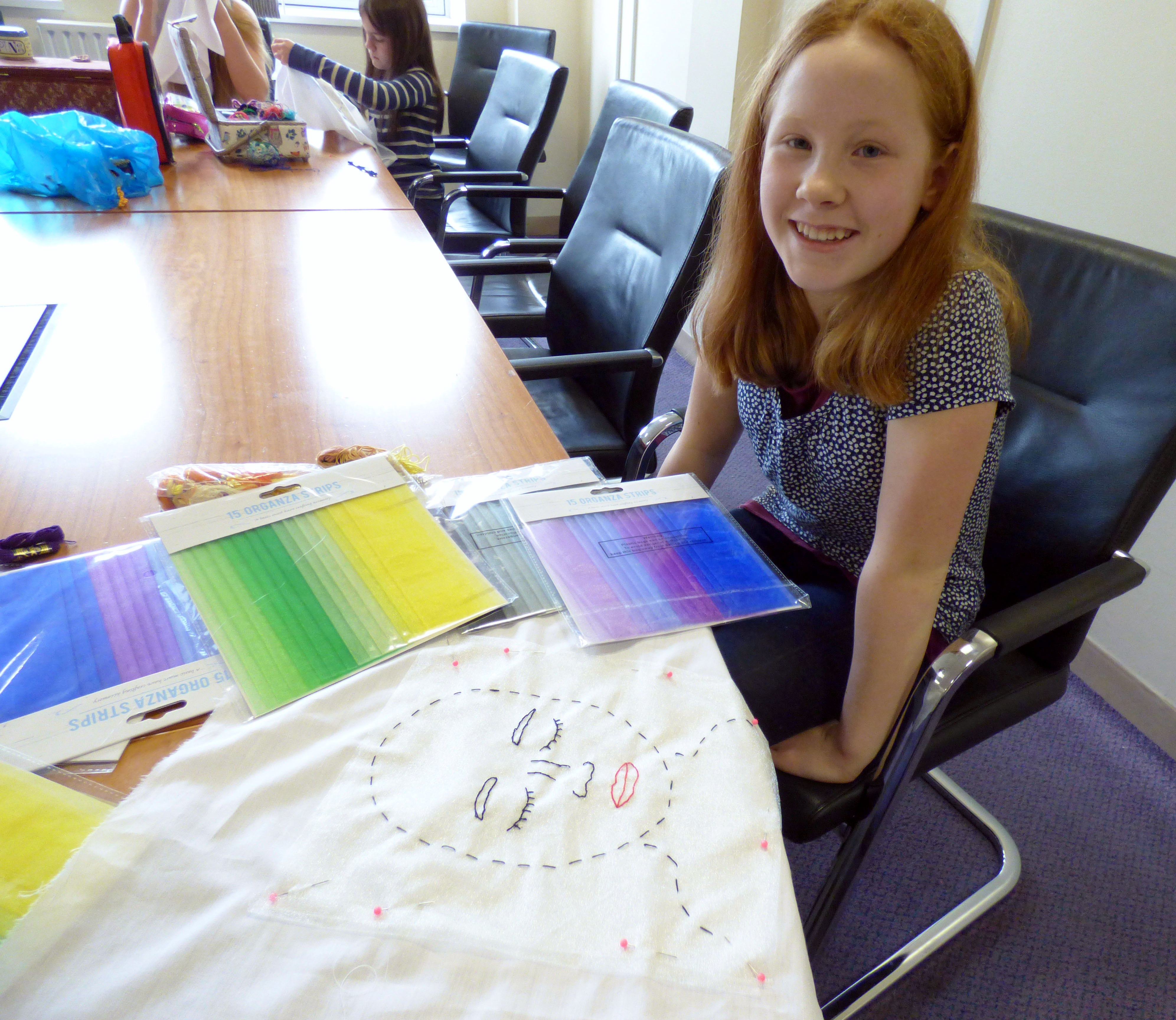 Zoe is ready to choose sheer fabrics for hair at Merseyside YE
