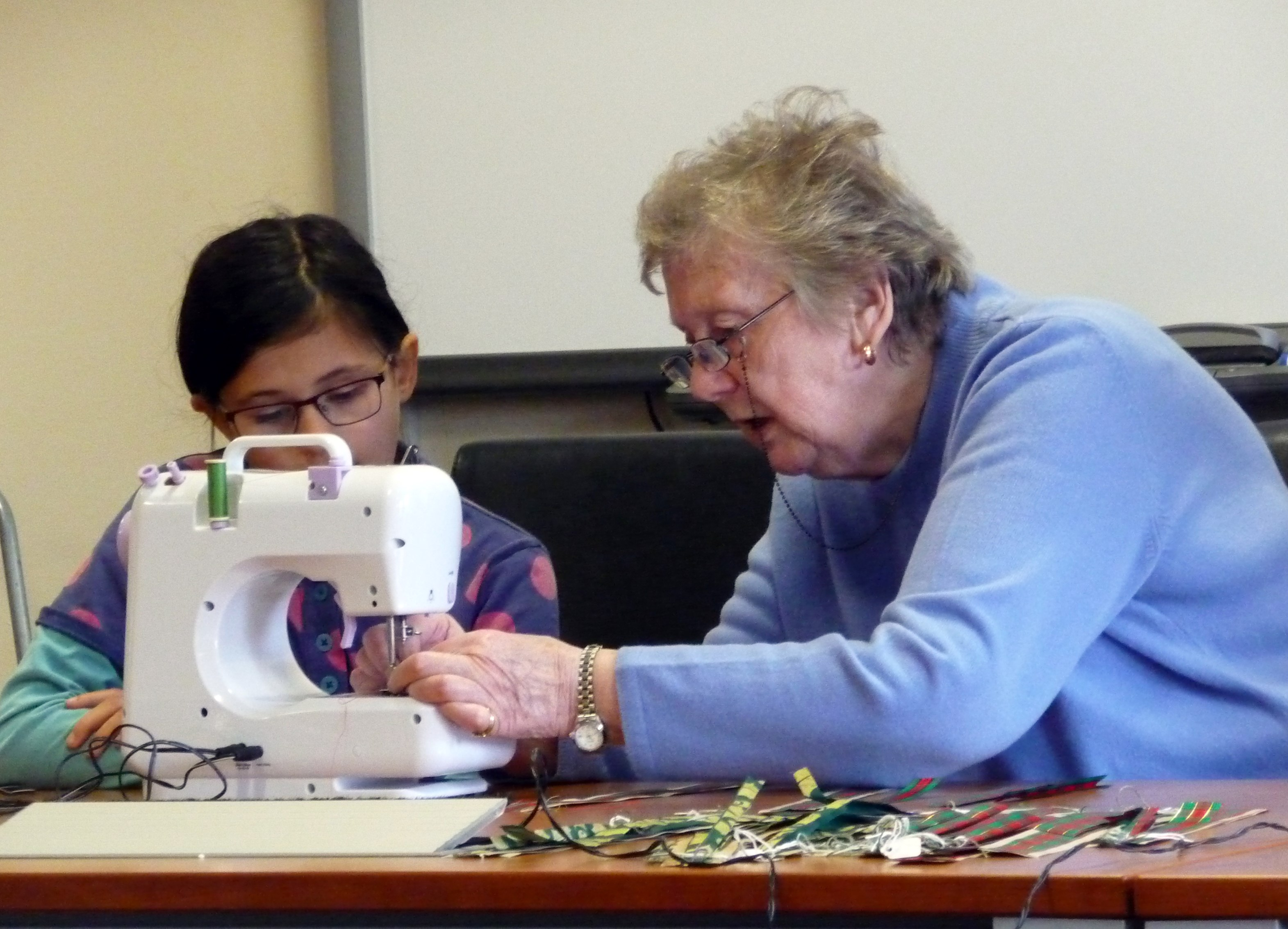 Val is helping Zoe with the sewing machine at our Nov 2015 YE meeting