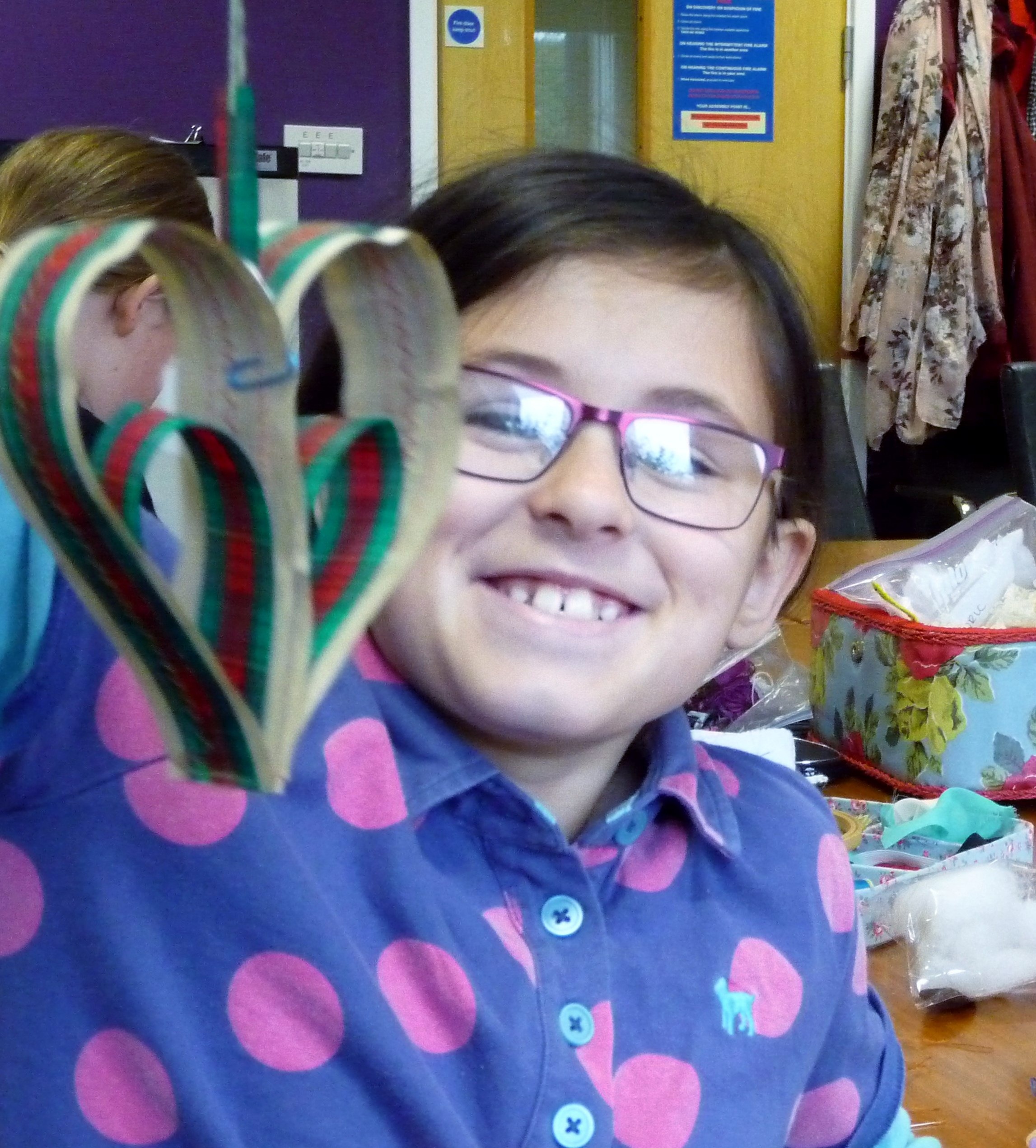Zoe is pleased with her machine sewn heart dcoration for Christmas