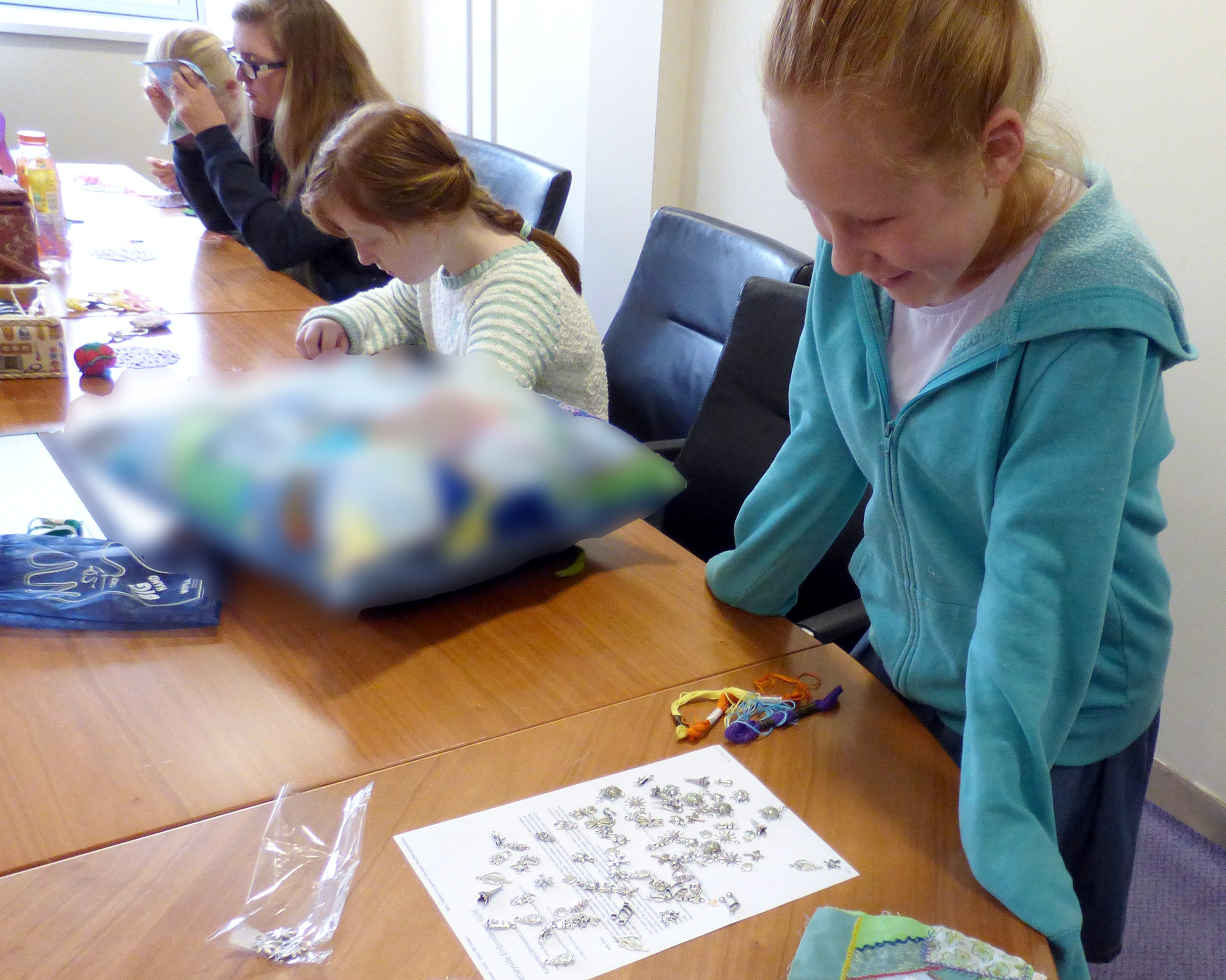 choosing charms for the crazy patchwork bag at YE group , Nov 2016
