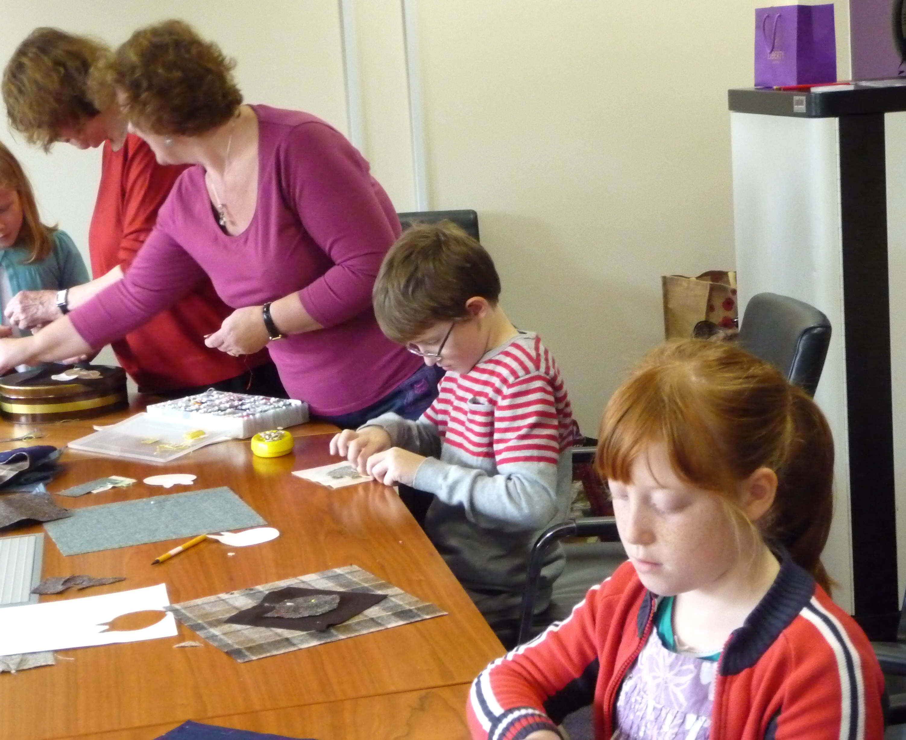 Fionn and Eilis are concentrating on their stitching