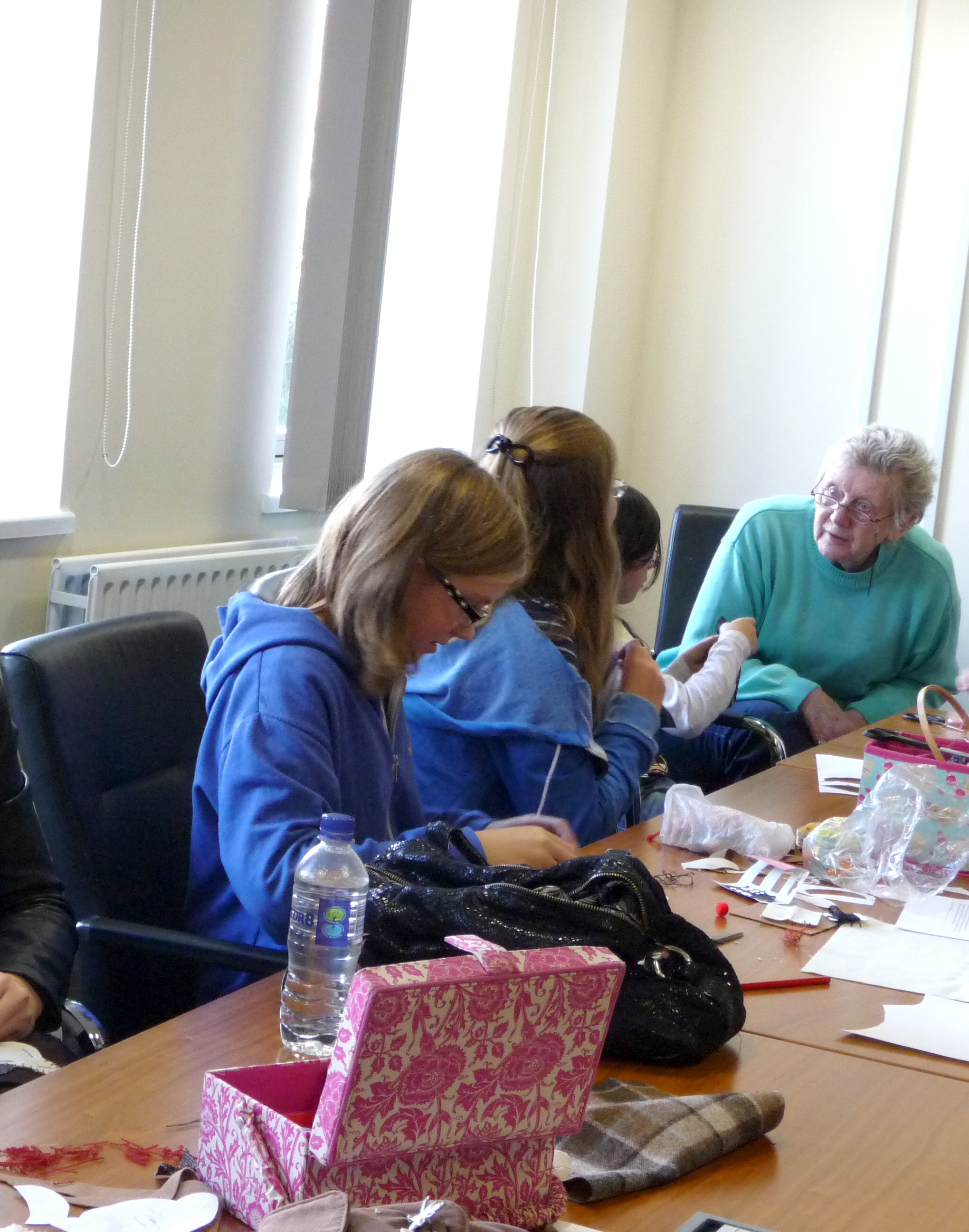 Val is helping some of our group with their stitching