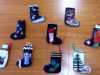 a collection of needle-felted Christmas stockings made by Merseyside YE group