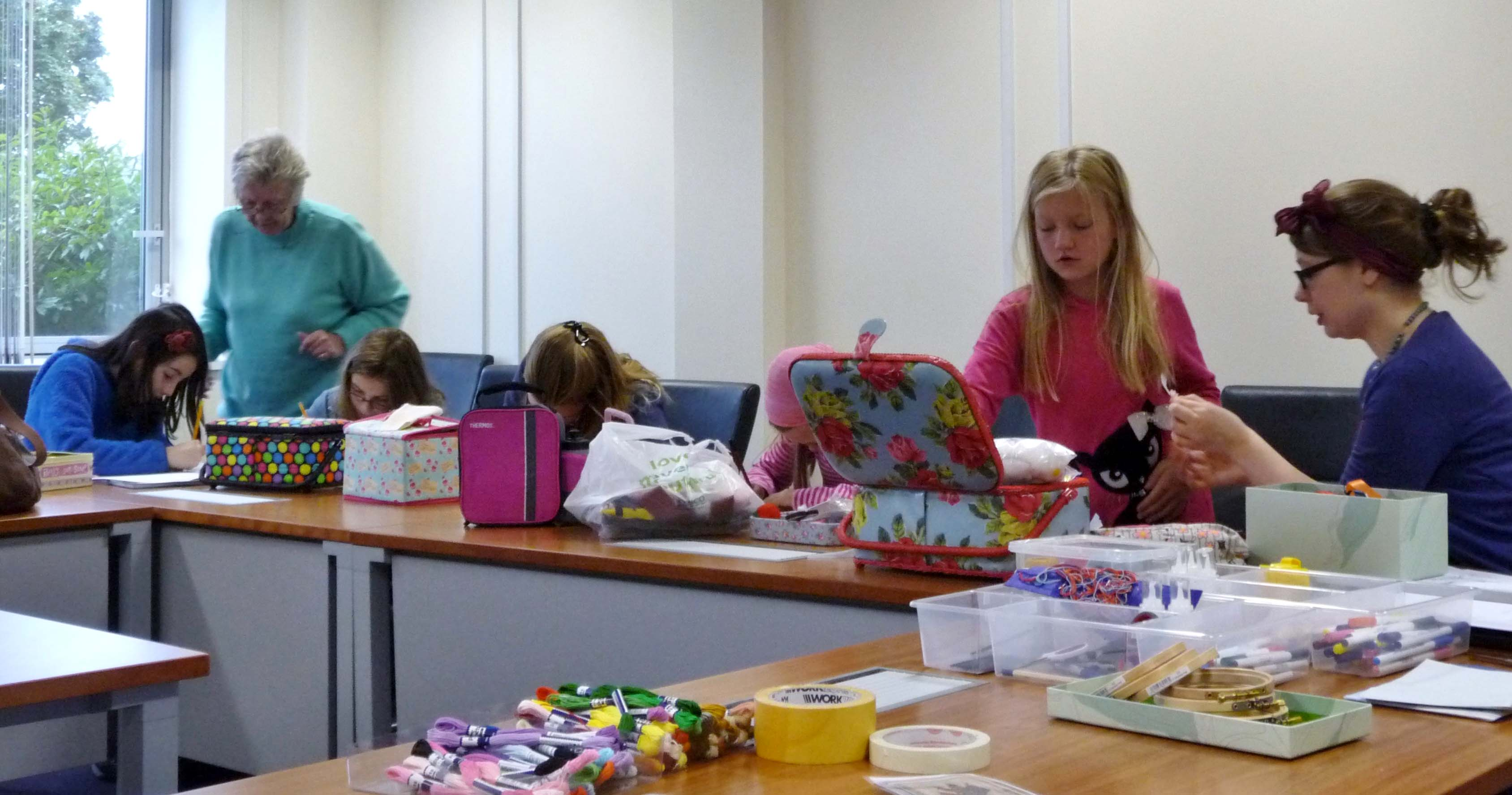 some of our Group are designing postcards to embroider with Val Heron and Becky Waite to assist