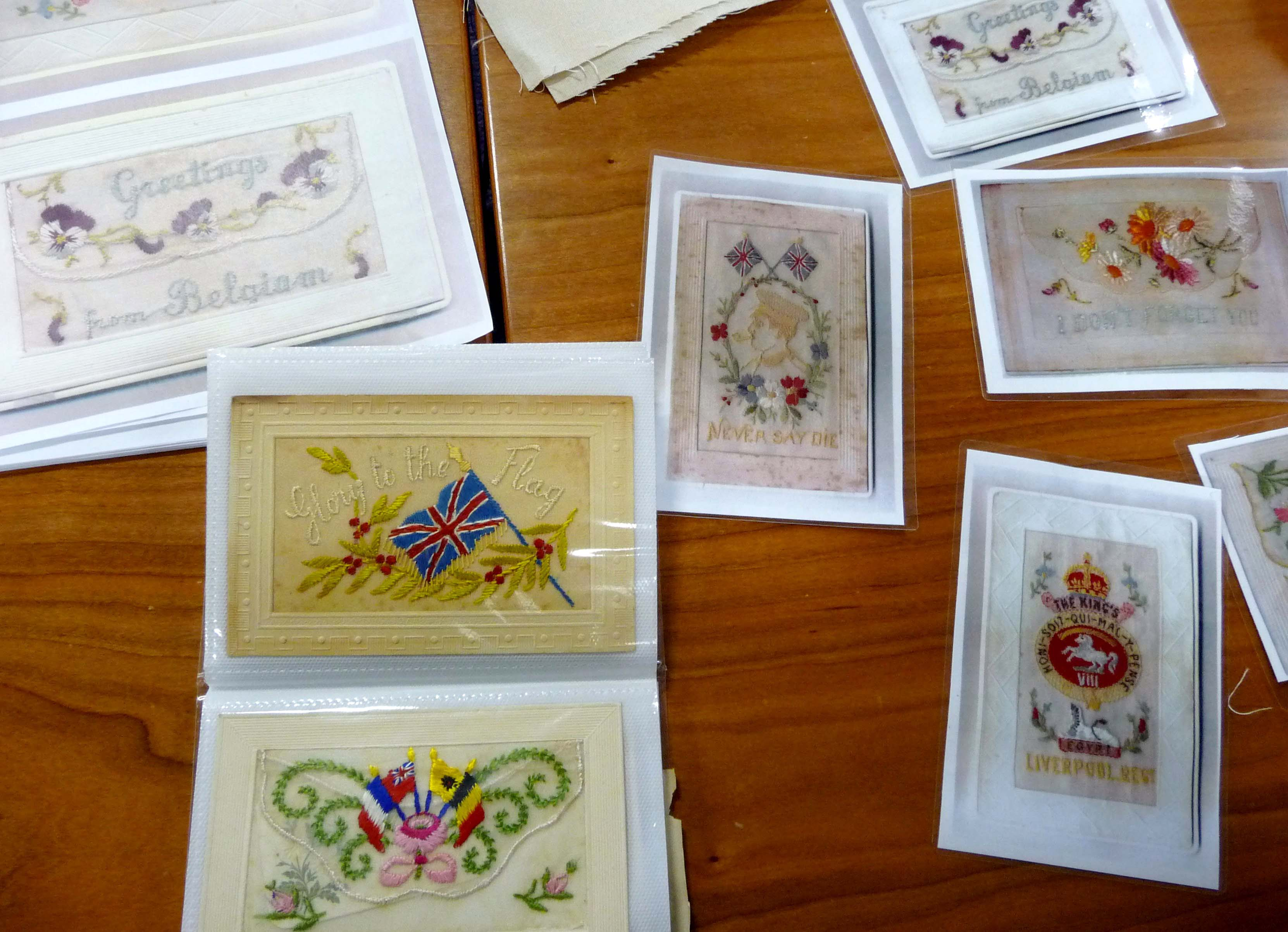 these are some old embroidered postcards that we showed the girls to inspire them