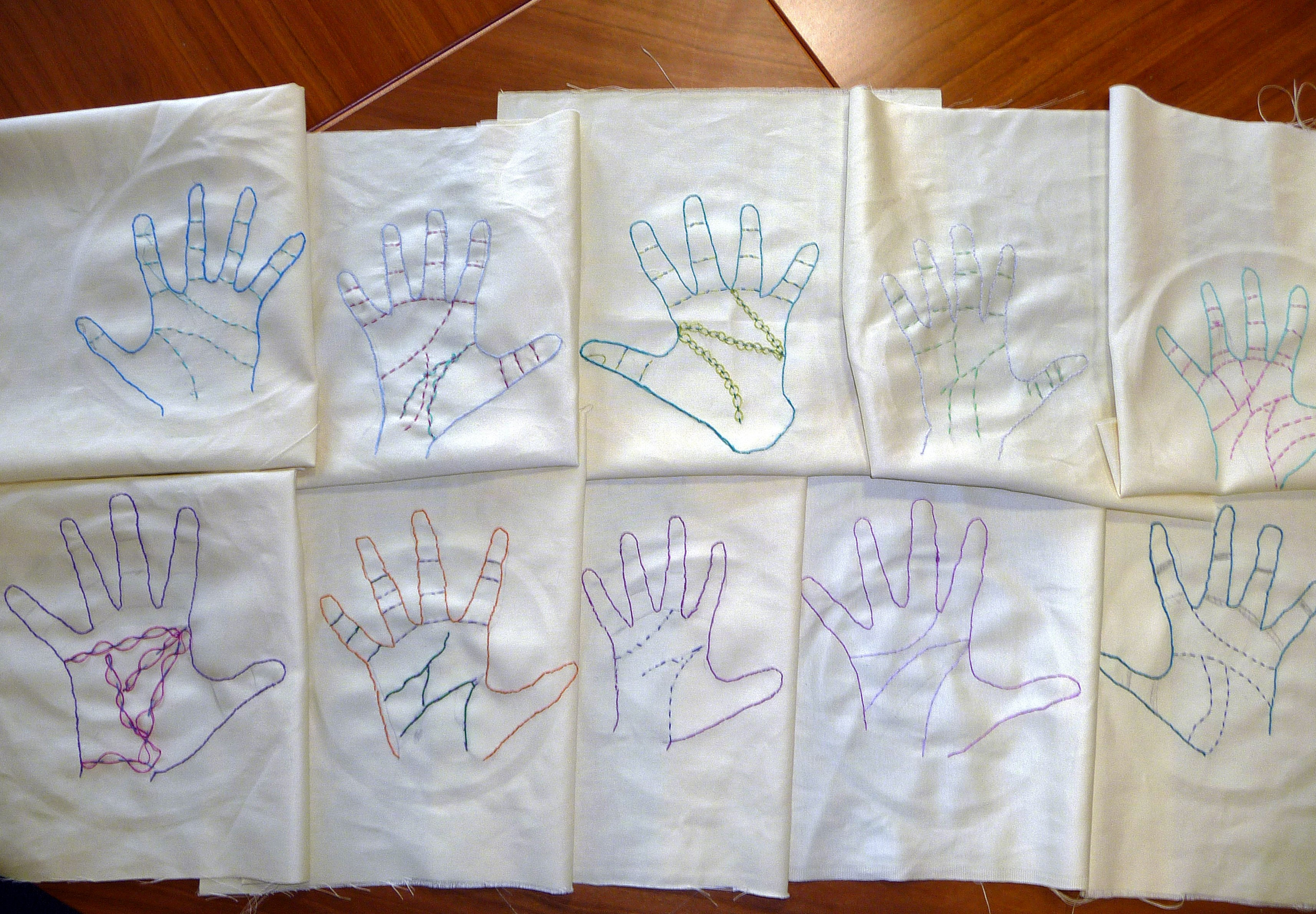 """Merseyside YE embroidered *fortune telling hands"""" this month. This is a display of all our embroideries at te end of the day"""