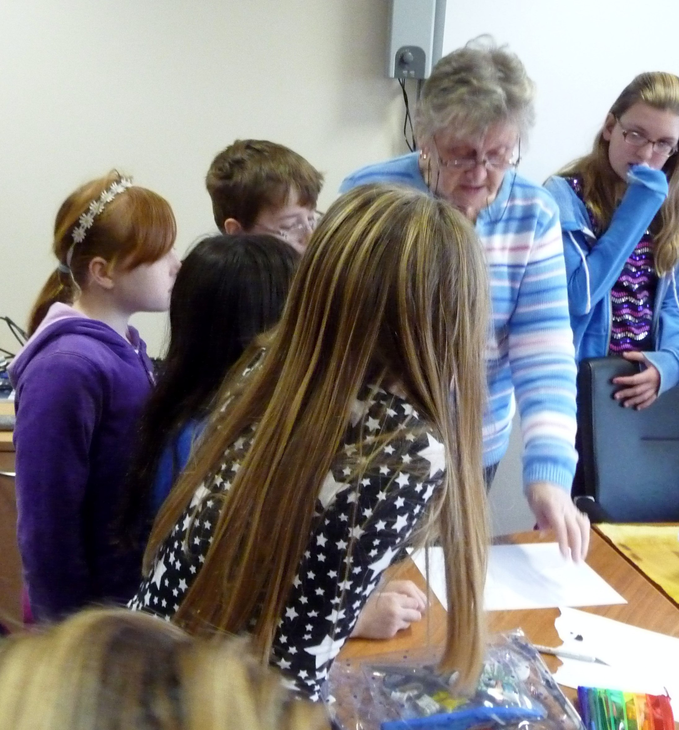 """Val is demonstrating to our YE Group how she used Markel pens to stencil the background of """"In Our Liverpool Home"""""""