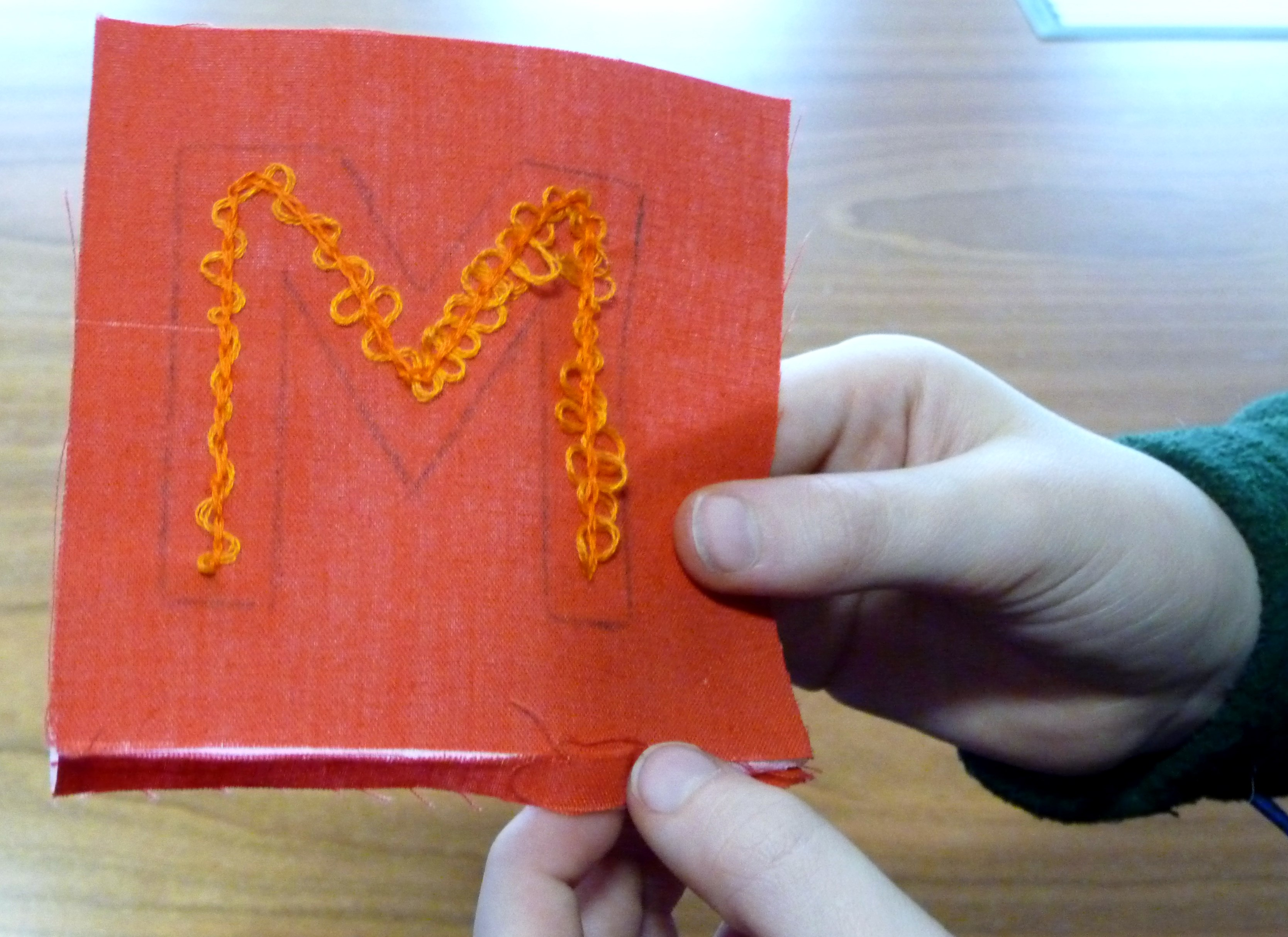 we embellished the letters we began last month with whip stitch