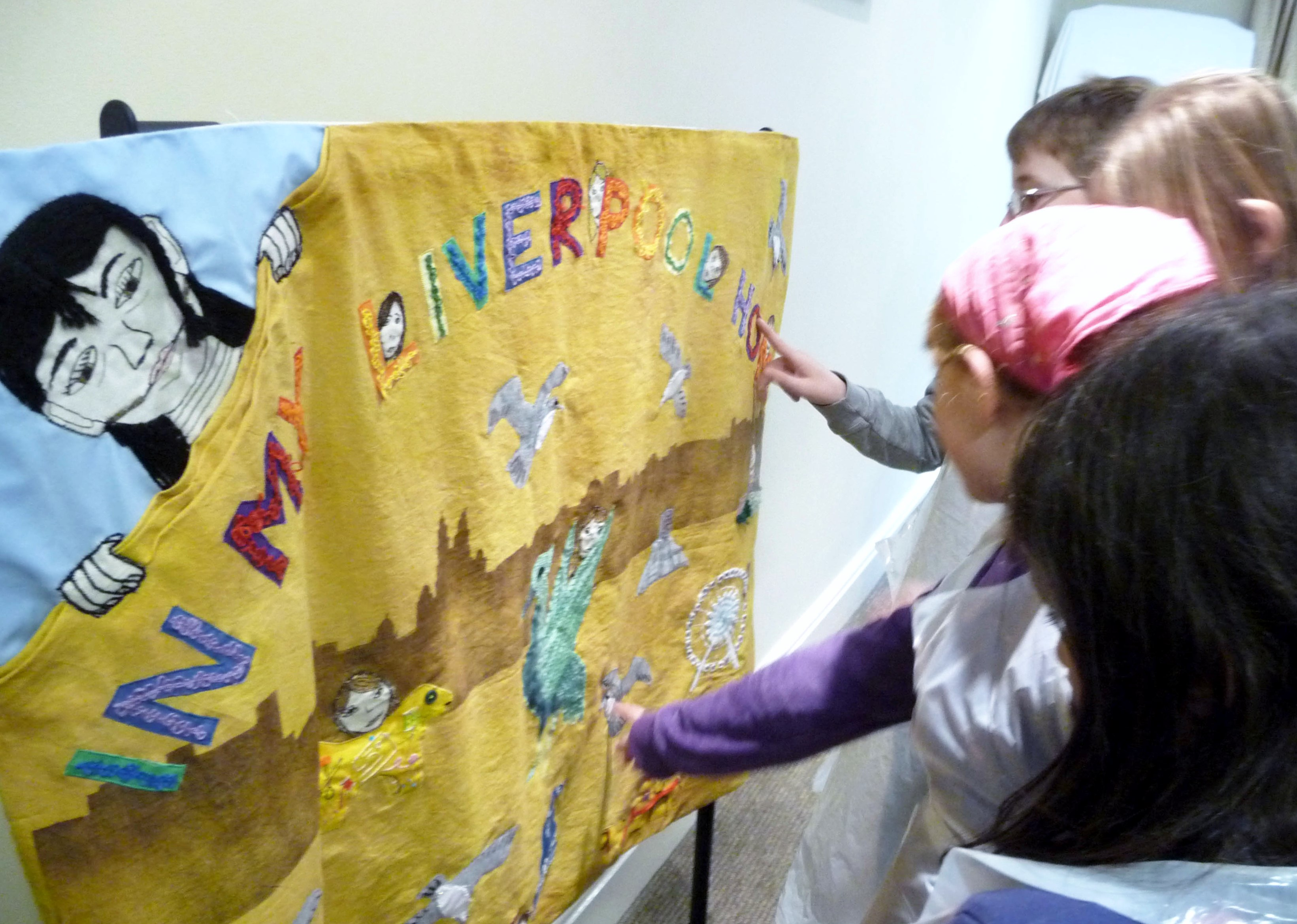 Merseyside YE are admiring the embroidered panel they made as a Group Project. it was on display at NW Regional Day 2014