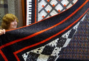 Norma shows us a double sided quilt by Yvonne Davies, Allerton Piecemakers Group