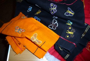 fabrics hand embroidered with butterflies, which will be joined together to make a quilt