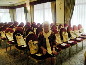 """Ruby Porter MBE with cotton """"goodie bags"""" made in Sreepur and given out at NW  Regional Day 2014"""