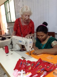 This is Ruby Porter MBE with Parul who is sewing up the bookmarks in Sreepur, Bangladesh, Nov 2014