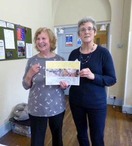 Norma Heron is presented with her 5o year gold badge by MEG Chair Kim Parkman