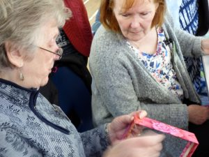 Val Heron is demonstrating ladder stitch at MEG Napkin Box Workshop with Val Heron