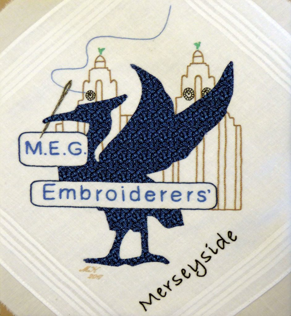 handkerchief square with MEG logo embroidered by Michele King