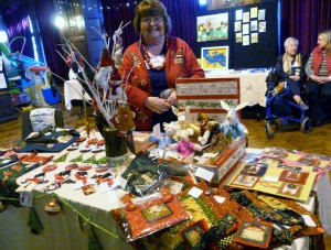 June Howard with her stall before the doors opened at 2013 MEG Christmas party