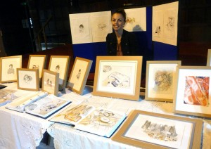 Hanna Wyn Roberts with an exhibition of her embroidered pictures at 2014 September Tea Party