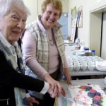Margaret Gold, one of Merseyside E.G.'s longstanding members, and Beryl Webster, our newest member, cut our 60th Anniversary cake