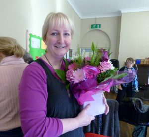 Sarah was presented with a beautiful flower arrangement as she left the committee after 12 years of service, October 2016