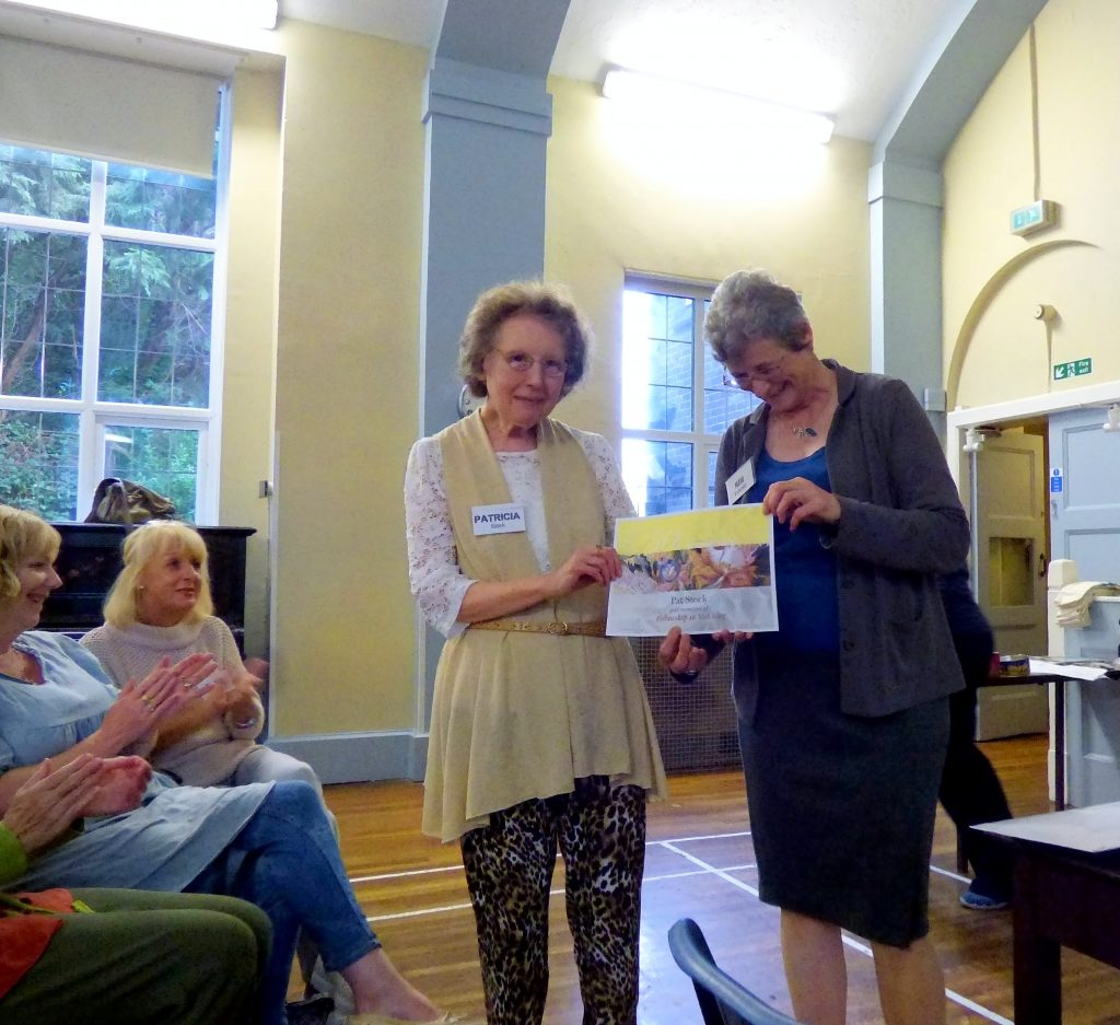 Pat Stock is presented by Kim Parkman with her certificate to celebrate 50 years as a member of Embroiderers' Guild