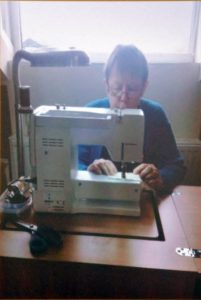 Marie at the sewing machine