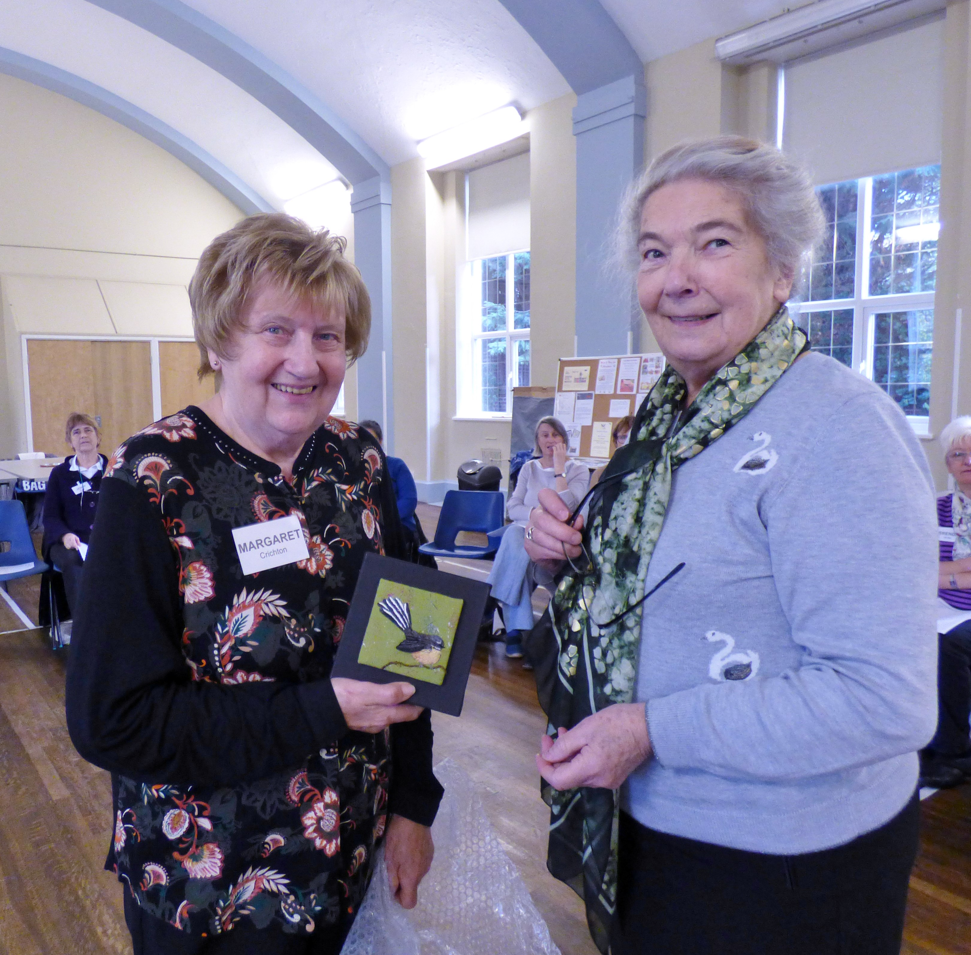 Margaret Crichton was placed second in Visitor's Vote at our Endeavour exhibition 2018. Vicky Williams presented her with an embroidered picture by Caroline Strachan