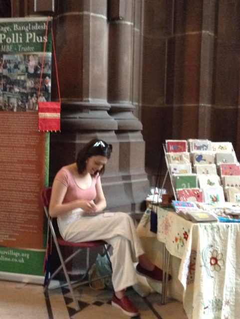 Ruby's granddaughter Finni at Threading Dreams exhibition in Liverpool Cathedral