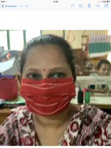 Maya is modelling masks that Parul has made, Sreepur 2020